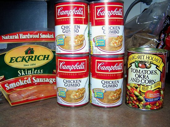Skinless smoked sausage, 4 cans of Cambells 'chicken gumbo', 1 can of Margarete Holmes Tomatoes/okra/corn.