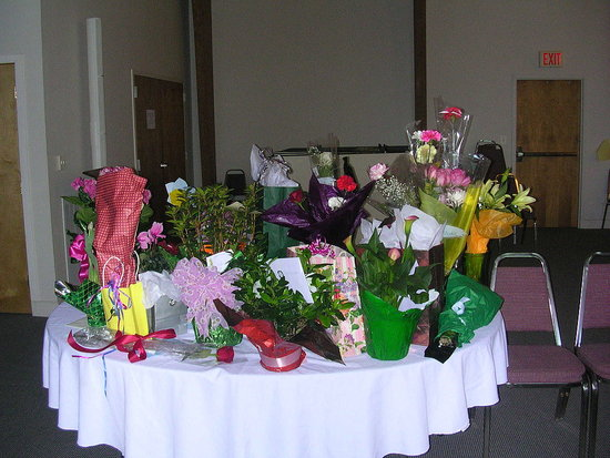 Gift table-Guests were asked to bring fresh cut flowers to make a center piece for Linda (we didn't get to that it was hectic as everyone came at once and some 30 minutes early) but some bought gifts and potted plants