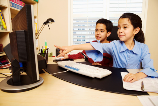 Boy and Girl Using Computer