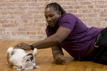 Photo of Lennox Lewis & his  Dog