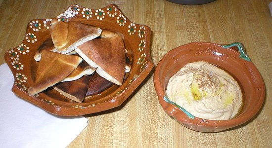 To serve, drizzle olive oil and sprinkle some paprika on hummus, accompany with pita chips. ENJOY!