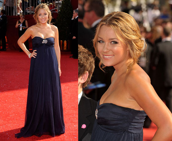 Her strapless navy Lauren Conrad Collection gown with diamond brooch at the