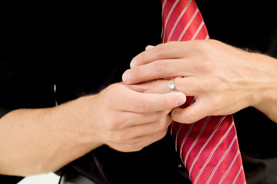 the lefthand ring finger to see if he or she is wearing a wedding band
