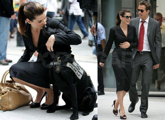 Bullock's handbag by Prada, peep-toe pumps by Christian Louboutin. Cute Dog