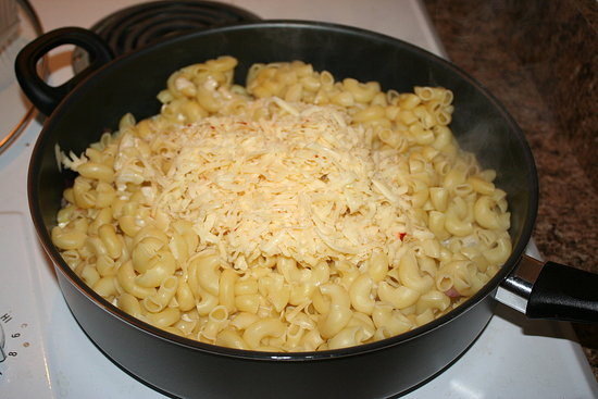 Add the noodles, cheese, and cream...