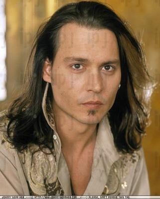 johnny depp hair. Johnny Depp Flips his long