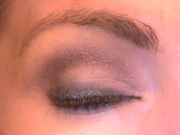 Use a darker color from the lash line up to your eye's natural crease, Jane Iredale's Dusk shown. Using something with a shimmer is better, much easier to blend. Using a flat grey shadow, I smudged the liner upwards and then lined all around my eye connec