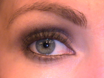 I used a black pencil to tight-line my upper lid and rim my lower lid too, again meeting at the inside corner of my eye. The look is more polished and easier to pull off when the lines meet and there are no 'loose ends.' Use a non-shimmer flash toned shad