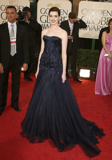 In a Giorgio Armani Prive royal blue silk gazar gown