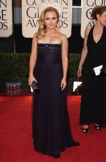 In a Gianfranco Ferre deep purple strapless seqined gown