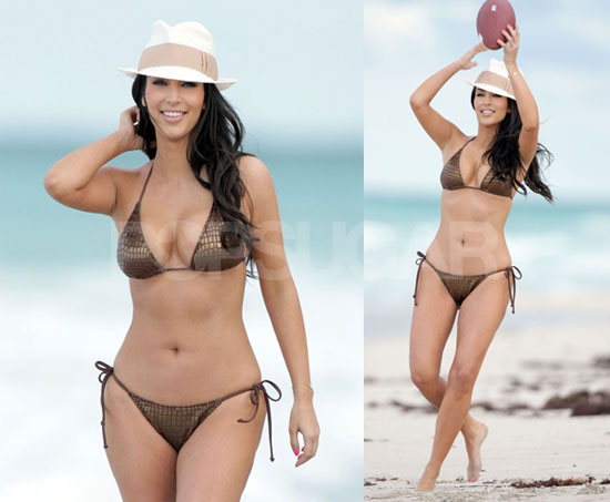 Kim Takes Time for a Little Bikini Football on the Beach