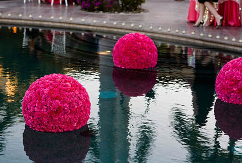 These flower balls would look great at an outdoor semi-formal party