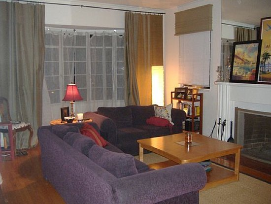 Highland-living-room-style-with-wooden-table-grey-curtains-purple-sofas-carpet-and-other-accessories