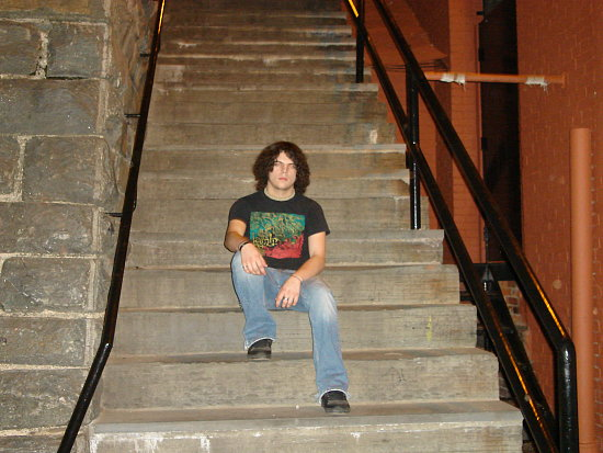 My younger brother, Cody, sitting on the steps; April 2007.