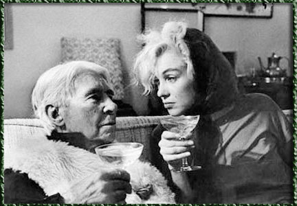 Marilyn and Carl Sandburg talking very deeply to one another.