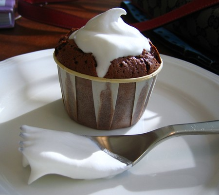 Miniature Molten Chocolate cake topped with fresh whipped cream