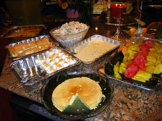 Puto (steamed rice cake) with cheese, Leche Flan, Fruit salad, Frozen Brazo de Mercedes, Chocolate sticky rice, various fruits