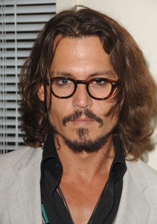 Johnny Depp Plays With Barbies Popsugar Celebrity