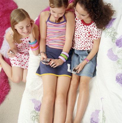 ... whether or not parents should buy mobile devices for their preteens