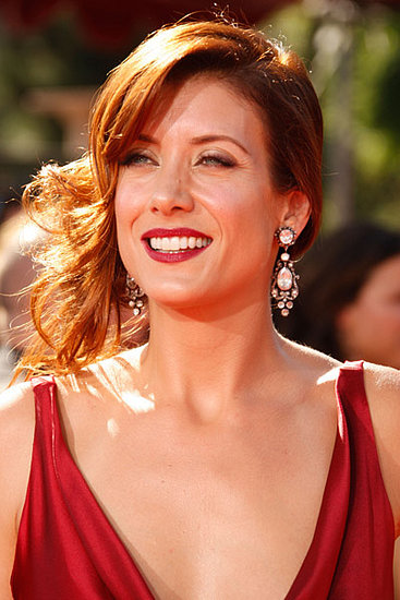 Kate Walsh makes it work with her red hair, red lips, and red dress.
