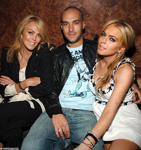 her family and friends (dina lohan and calum best)