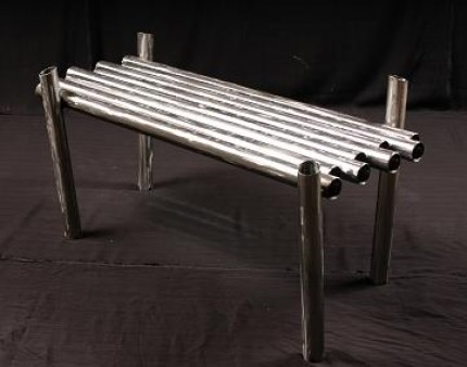 Weird furniture modern pipe coffee table popsugar home for Bizarre coffee table