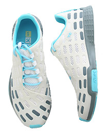 The Travel Trainer in White and Blue By Reebok ($36.95)