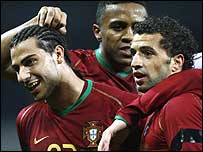Simao (right) is congratulated on his opener for Portugal