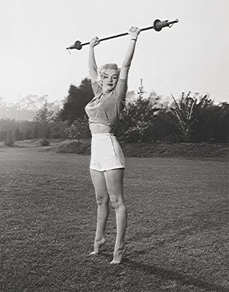 Marilyn working out with weights.