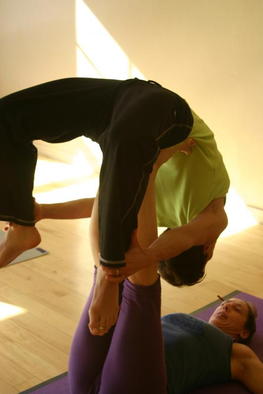 partner and inverted bow pose