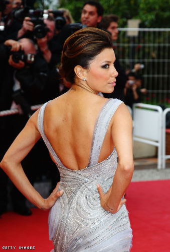 This classy updo, worn by Eva Longoria features a little height in the crown