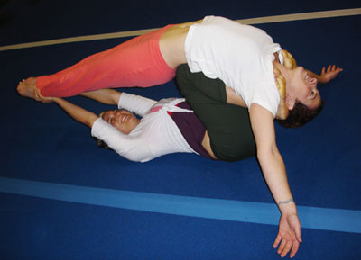 partner yoga pose supported flying arch  popsugar fitness