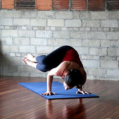 strike a yoga pose side crow  popsugar fitness