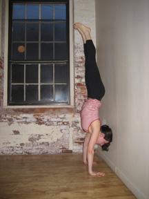 strike a yoga pose handstand trick  popsugar fitness